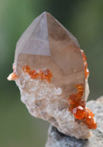 Orange Garnets on Self-Healed Smoky Quartz Phantom